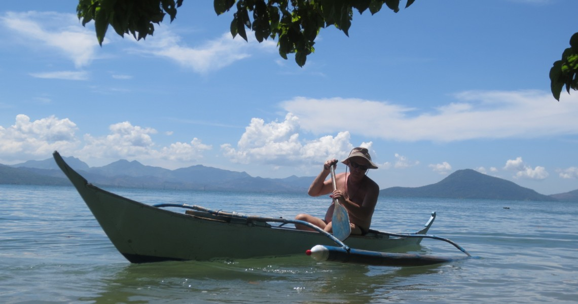 Ed paddling his canoe in paradise