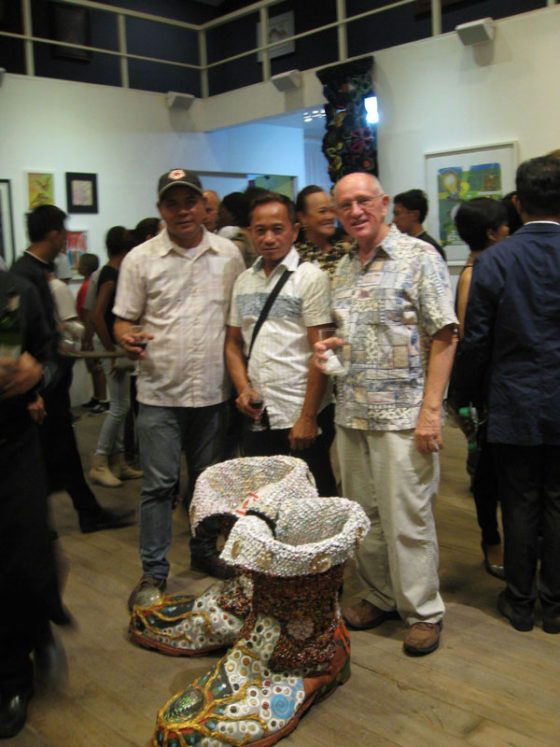 "At the ""Map for Climate Show Opening"" at Archivo 1984 Gallery, Makati City. Lemuel Cunanan, Edwin Toth and Henri Cainglet.  In front of us is Henri Cainglet's ""Walk of Hope I"" Giant Boots sewn together denim from the devastation into hope of times to come: These boots were made from denim and objects Henri found in the vicinity of Typhoon Haiyan (Yolanda) and around the areas affected by the Bohol earthquake in November 2013. They were sewn together to make ""The Boots of the Giant"". In Henri's words"" ""Some say the storm was a giant one, but when communities and mankind come together to work on something of importance, we become larger than that -- we become the Giants."" ‪Map for Climate Show Opening, Archivo 1984 Gallery. #mapforclimate"