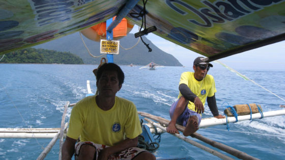 Our boatmen on the way to Underground River.