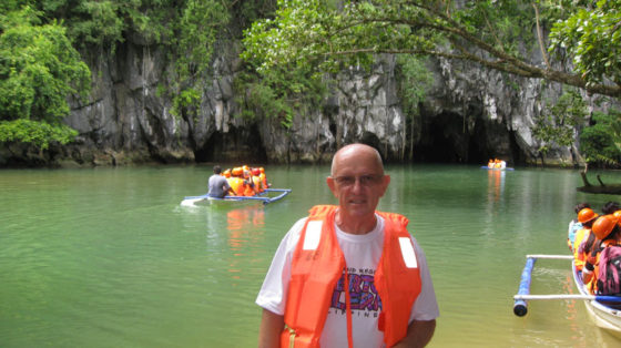 Ed with Underground River cave opening in background.