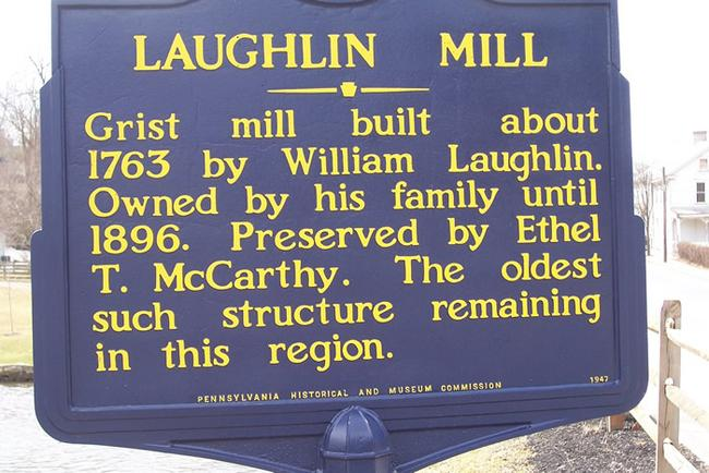 The Pennsylvania Historical & Museum Commission sign gives a brief history of the Laughlin Mill.