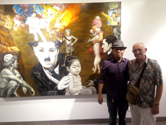 "Otto and Ed with artist's work ""Past and Present Allegories"""