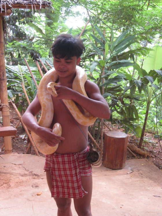 Palaw'an boy with pet snake.