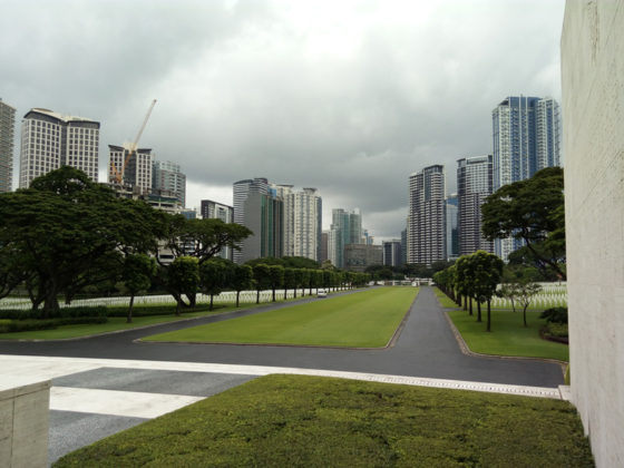 View from Memorial Courtyard to Bonifacio Global City skyline, American Manila Cemetery, Manila, Philippines