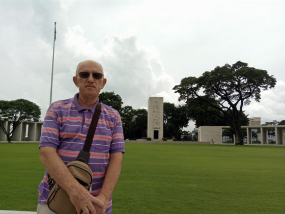 Ed in central courtyard with Memorial Chapel in background, American Manila Cemetery, Manila, Philippines